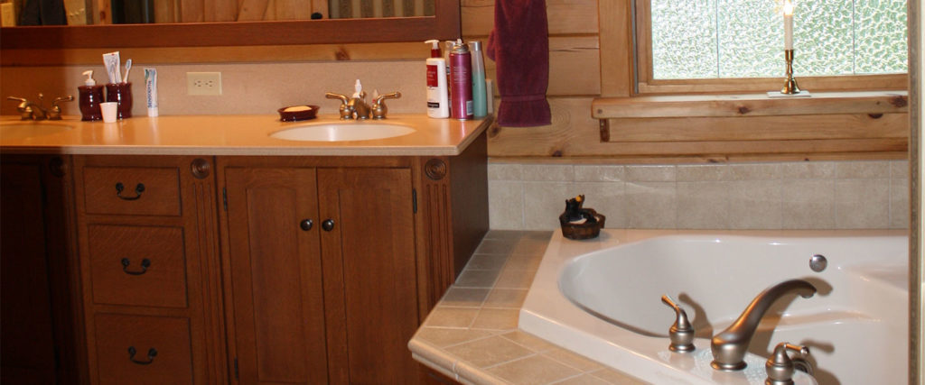 atglen log home bathroom with two sinks and tub
