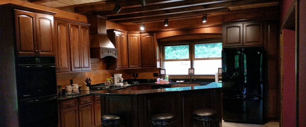 Bradford model log home with open concept kitchen
