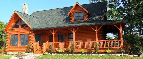 Two-story log cabin home built by Gingrich Builders