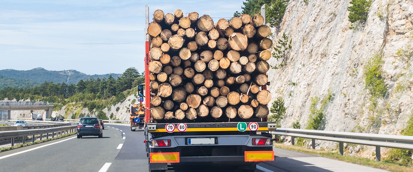 log cabin materials being shipped