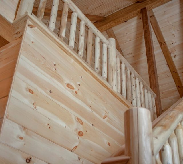 two story indoor balcony log cabin