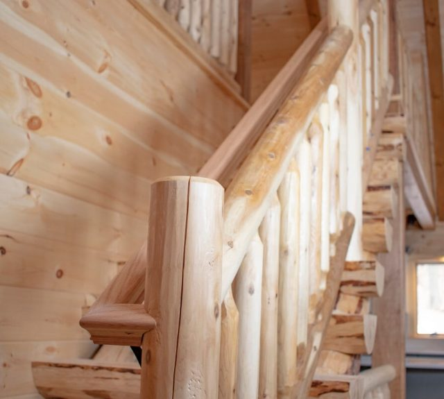 staircase with balcony in log cabin