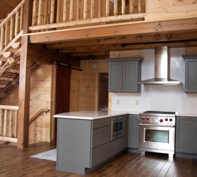 log cabin model home with open floor plan