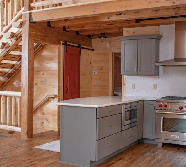 log cabin with open kitchen