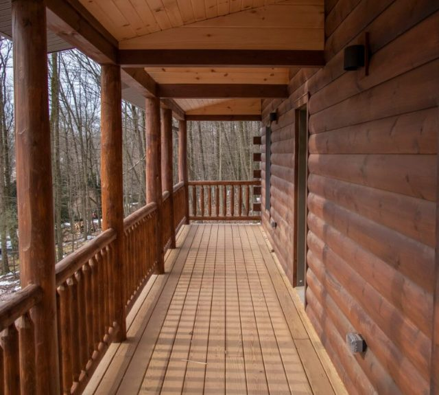 log home plans with balcony