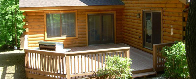small log cabin home deck