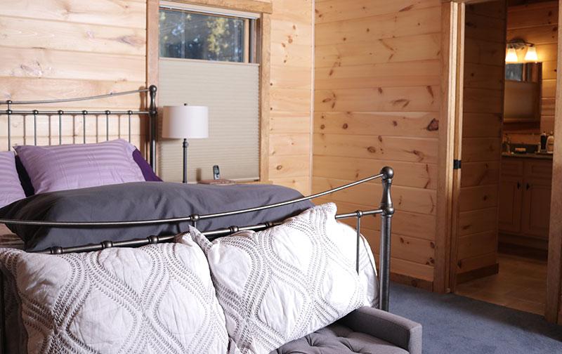 affordable log home master bedroom