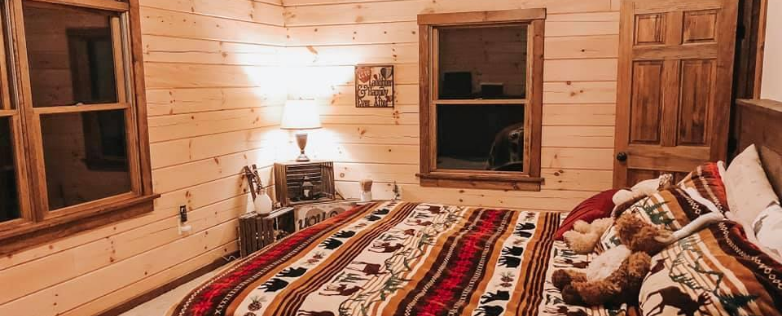 southern log cabin bedroom