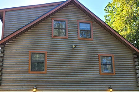 New siding on a log home restoration