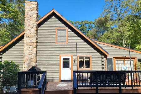 New siding upgraded to a complete log home maintenance project